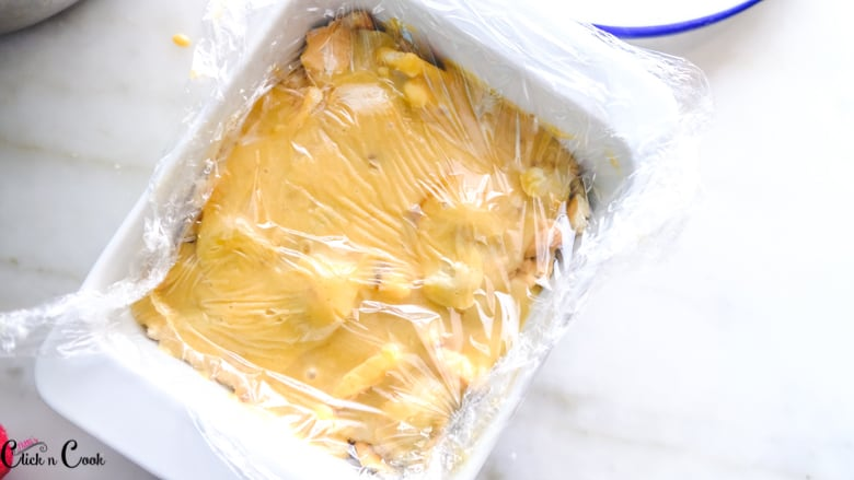 banana pudding is being wraped using cling wrap