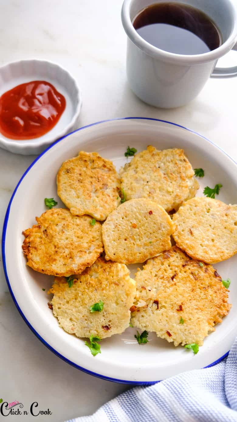 potato pancake recipe is served in small plate with dip aside