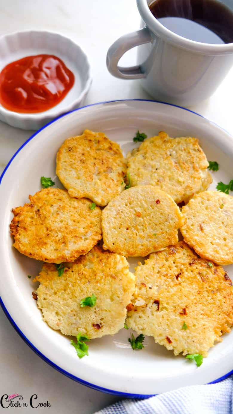 potato pancakes are served in small plate with dip and mug of coffee aside