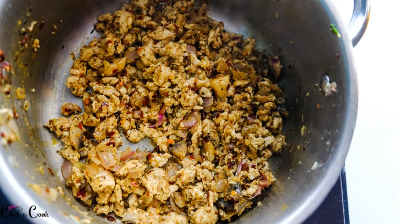 minced chicken is being cooked in deep saute pan