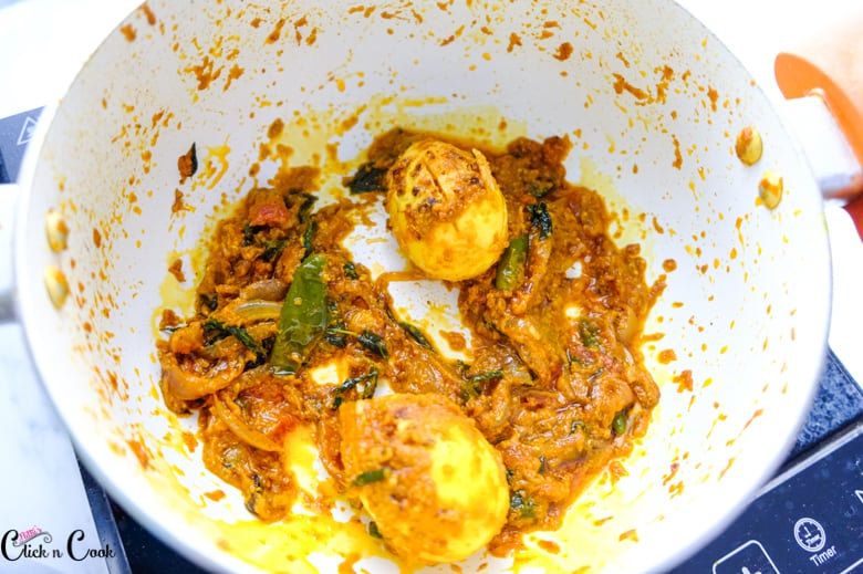 two eggs with masala is in deep pot