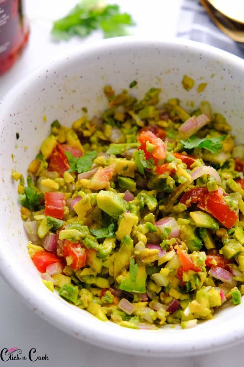 close up shot of guacamole served in bowl