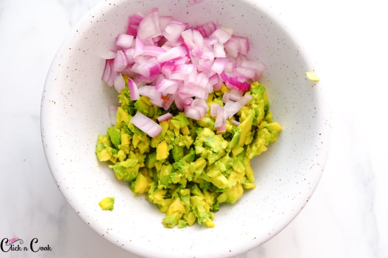 chopped onion and avacado are in bowl
