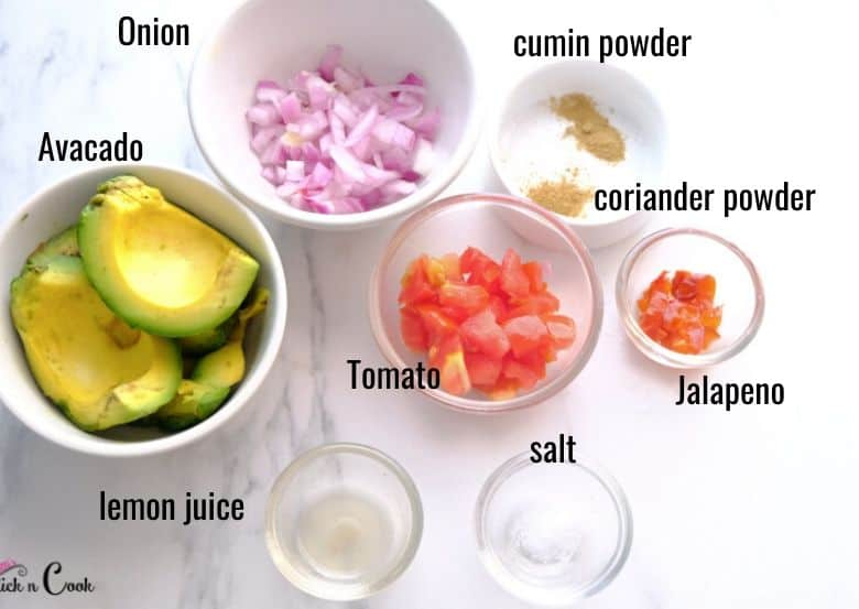 ingredients to make guacamole are taken in small bowl