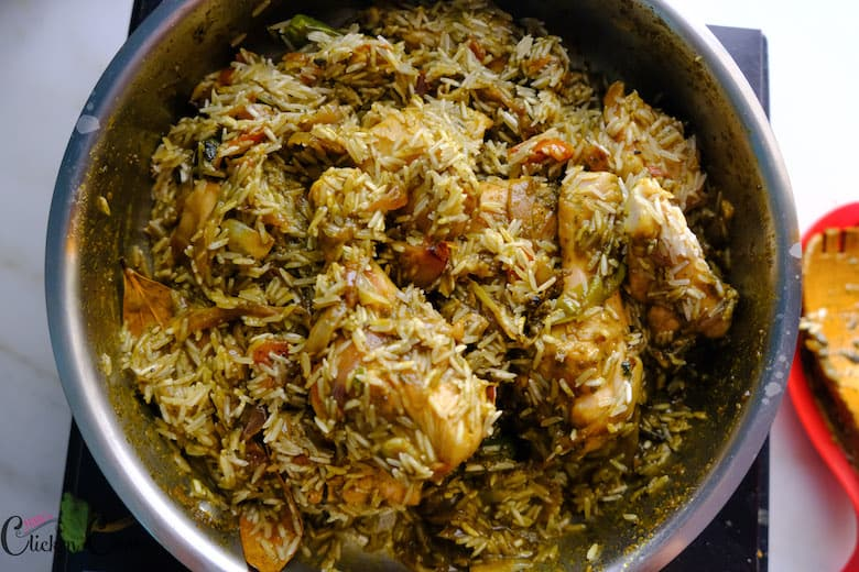 chicken with rice is in saute pan