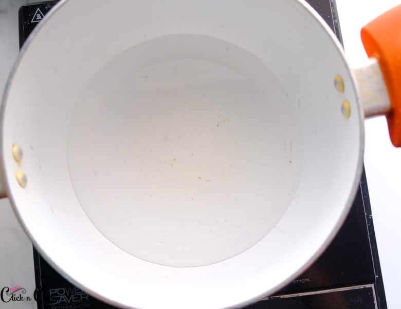 water is being added to sauce pan