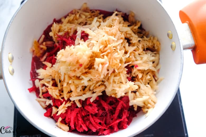 grated beetroot and potato in sauce pan