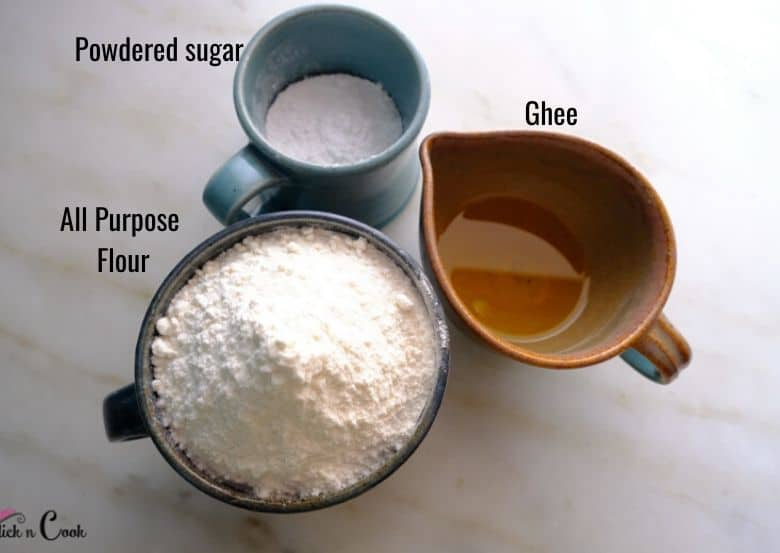 all purpose flour, powdered sugar and clarified butter are taken on bowl