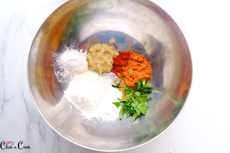 spices are being added to mixing bowl