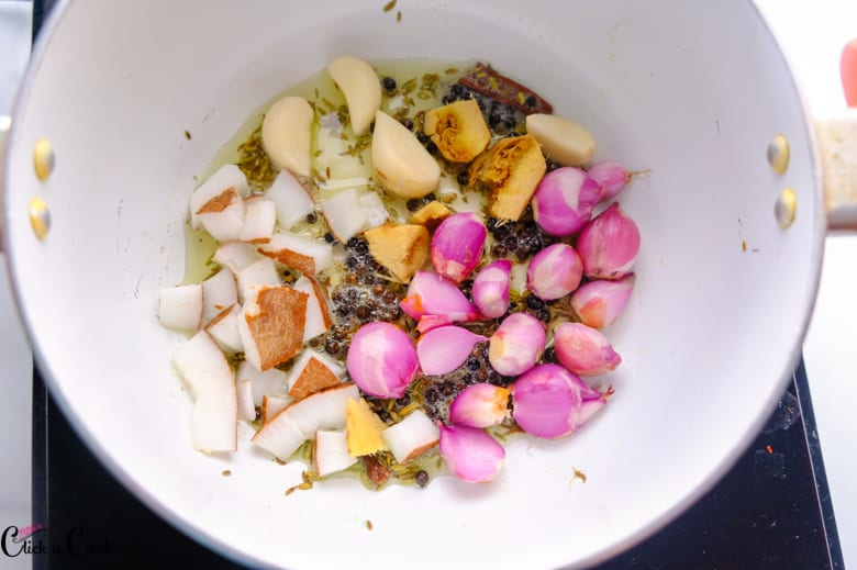 shallots, ginger,garlic, peppercorns are fried in oil in sauce pan