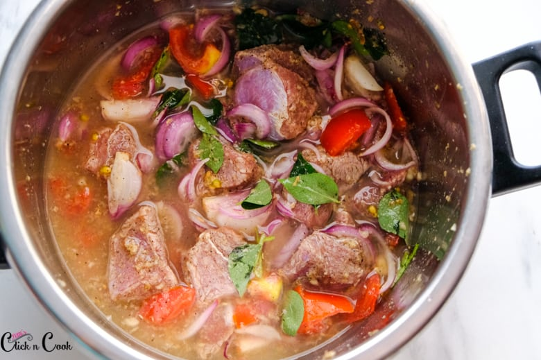 mutton, onion tomato and water is in pressure cooker