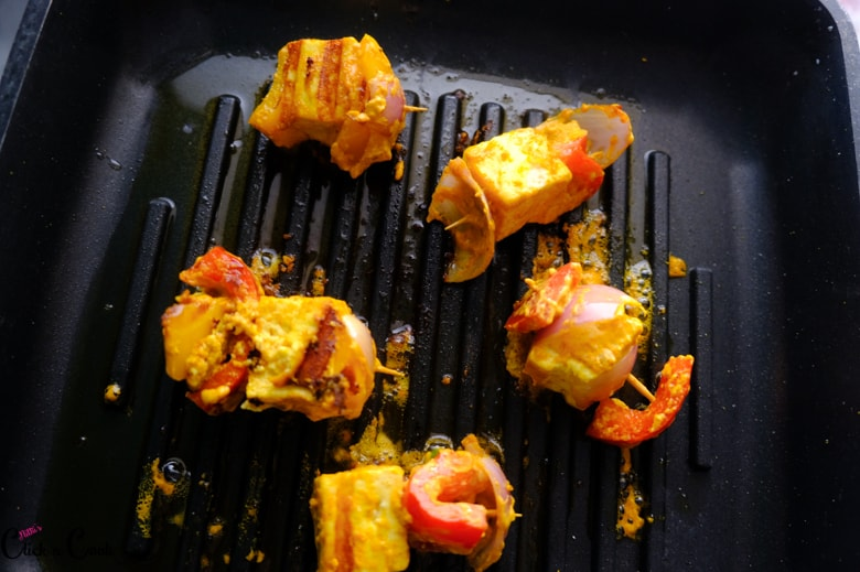 cottage cheese is being grilled in grill pan
