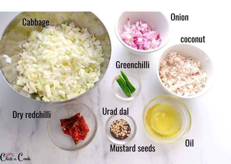 chopped cabbage, onions, coconut, chillies are taken in glass bowl