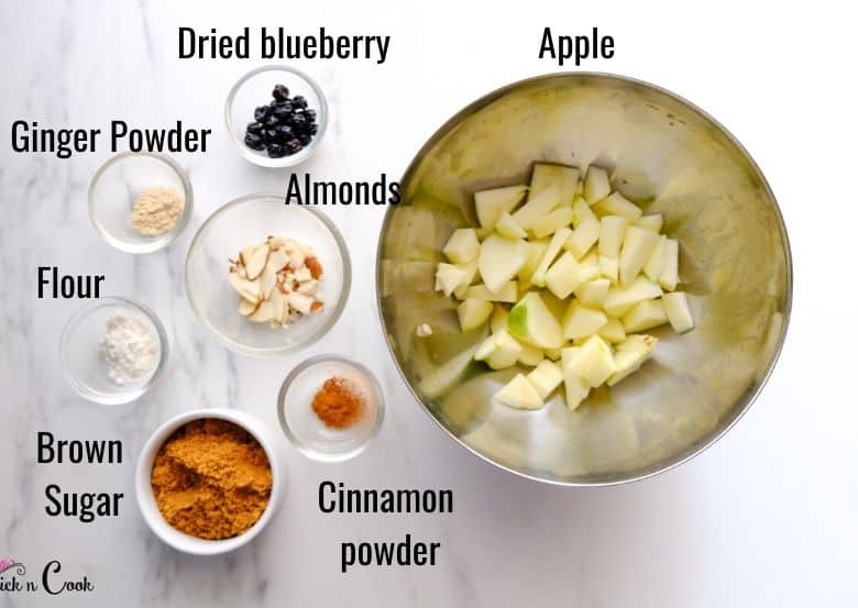 diced apple, brown sugar, cinnamon are in glass bowl