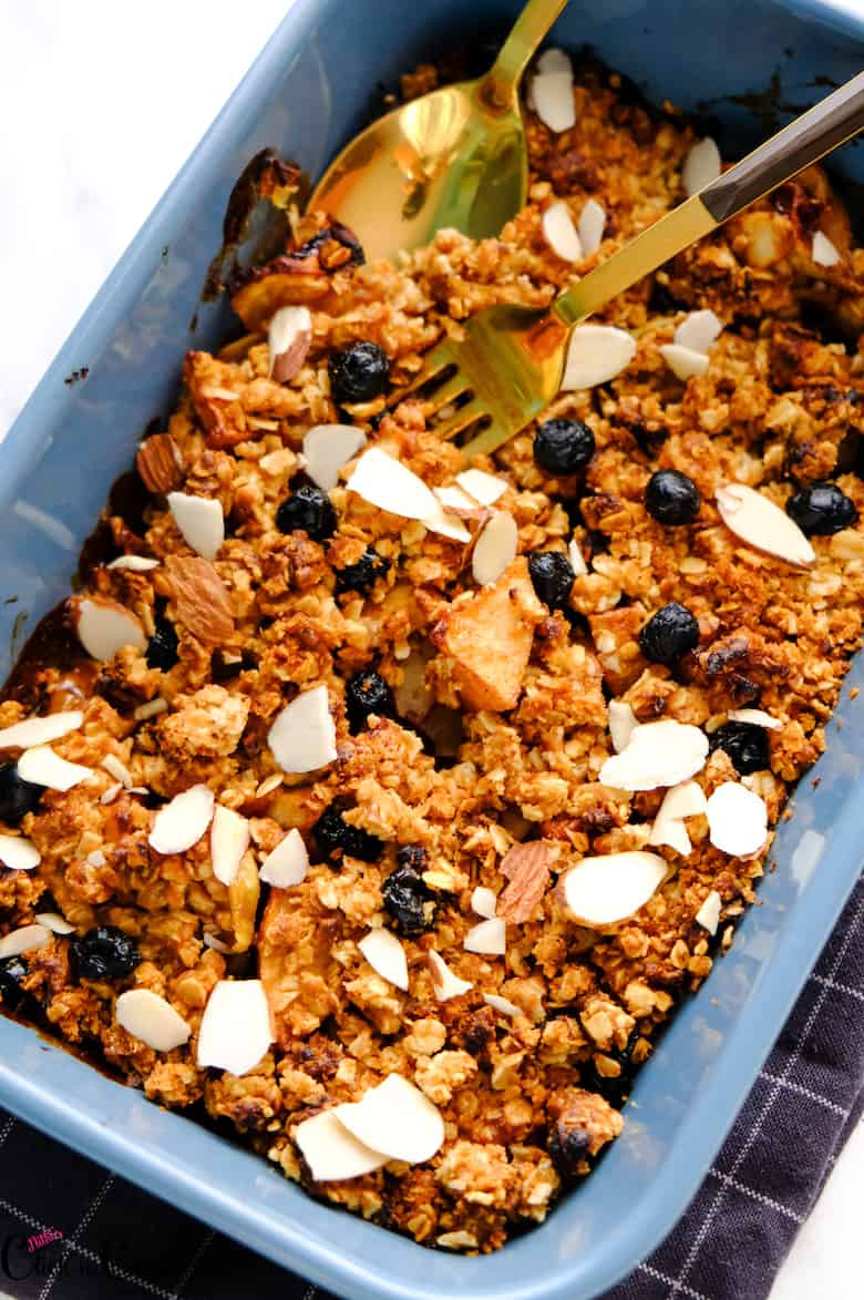 Apple Crisp is in the blue baking tray with fork in.