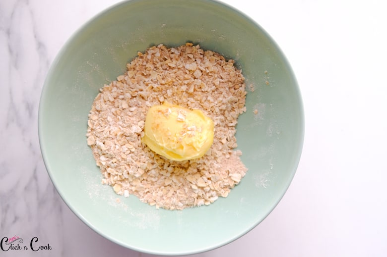 oats and butter in green bowl