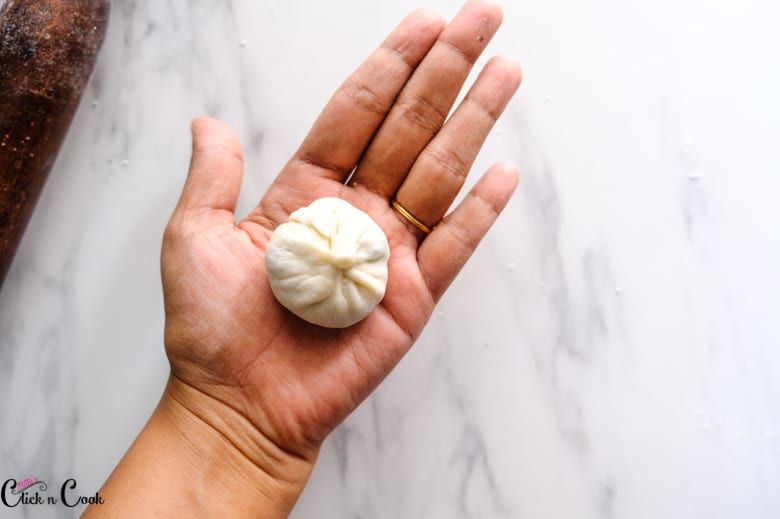 chicken momos is made is kept on the palm