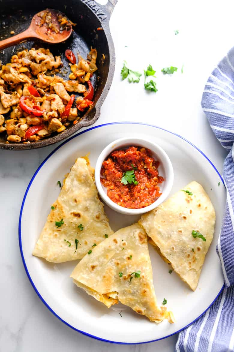 Chicken quesadilla recipe served in white plate with dip aside