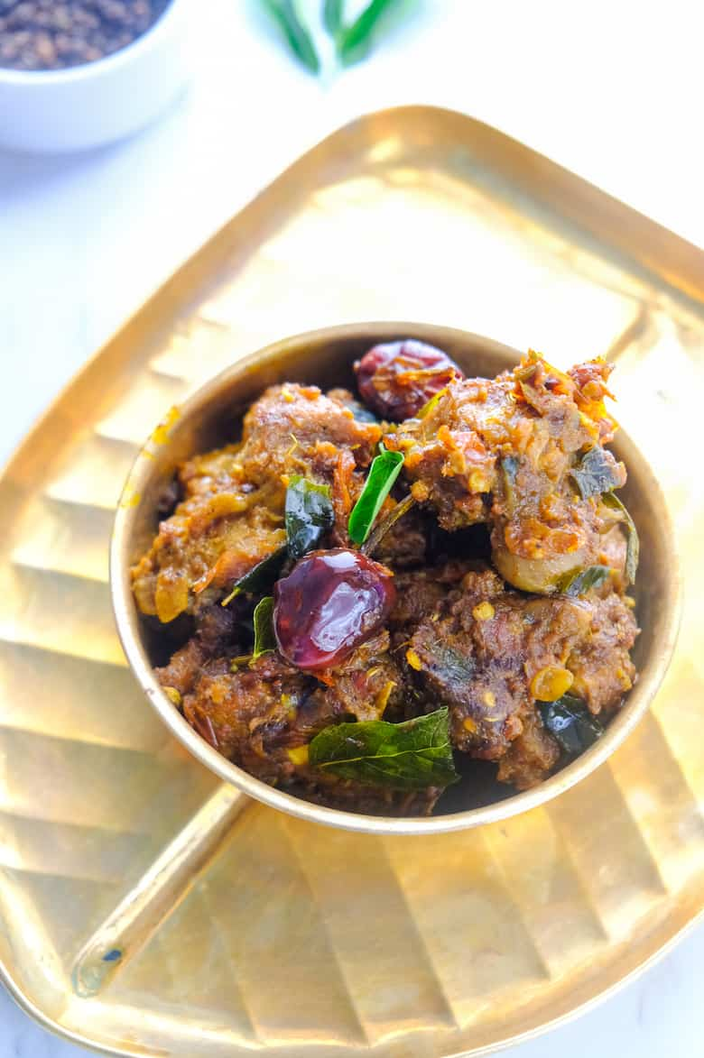 close up shot of mutton chukka served in brass bowl and plate
