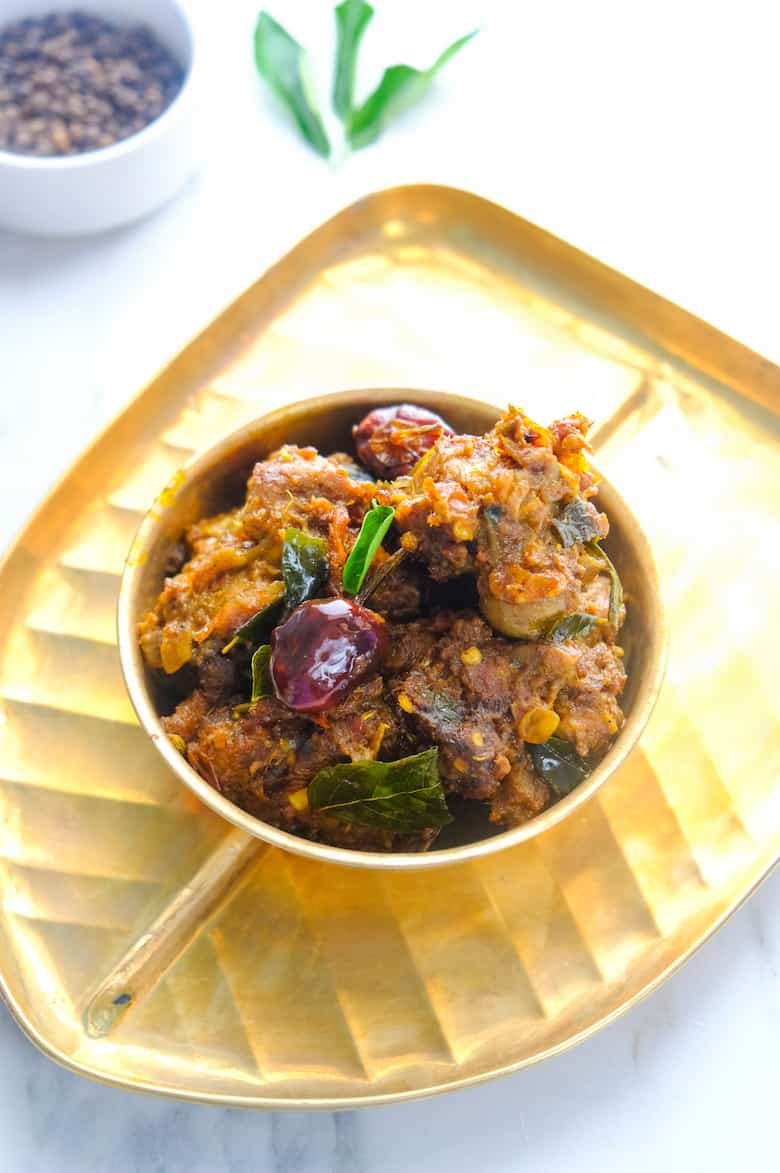 close up shot of mutton fry is served in brass bowl and plate