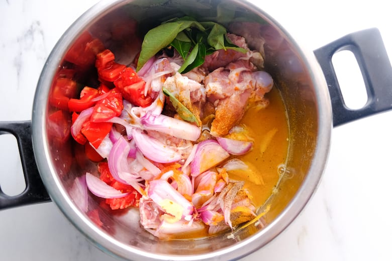 mutton, onion, tomato and water in pressure cooker
