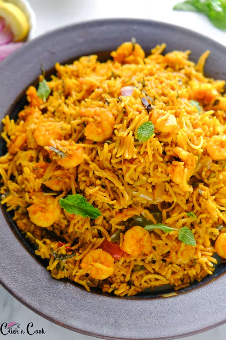 close up short of prawn biryani served in plate