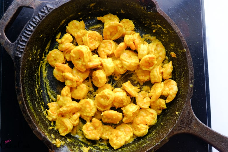 fried prawns in cast iron pan