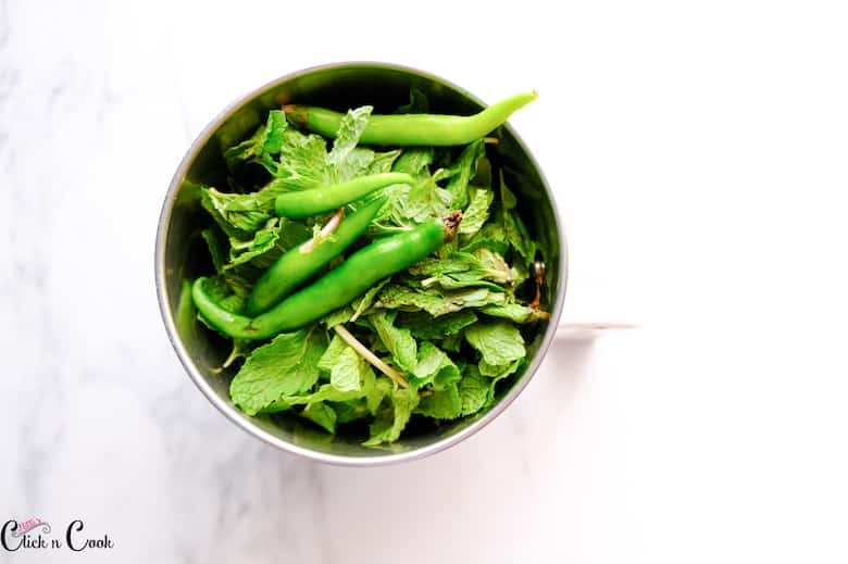 green chilli and mint leaves are in blender