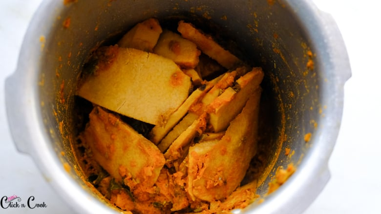 cooked yam slices are in deep pot