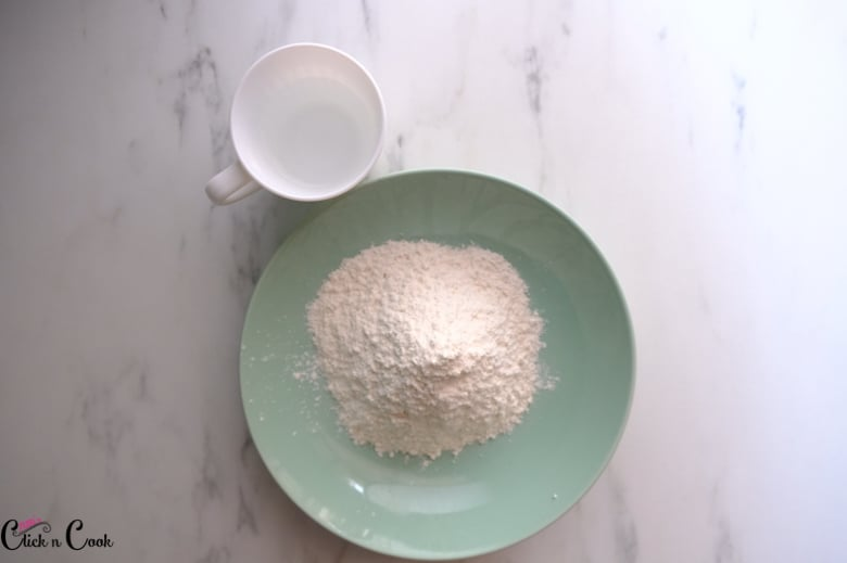 a bowl of flour and cup of water aside