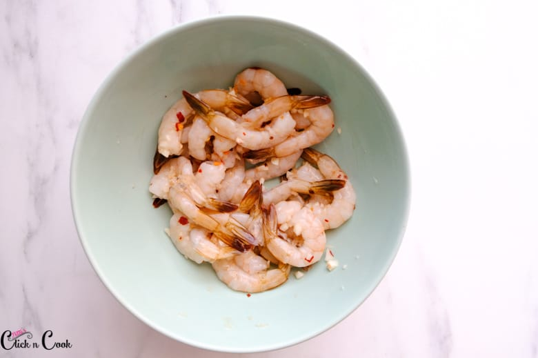 marinated shrimps in green bowl