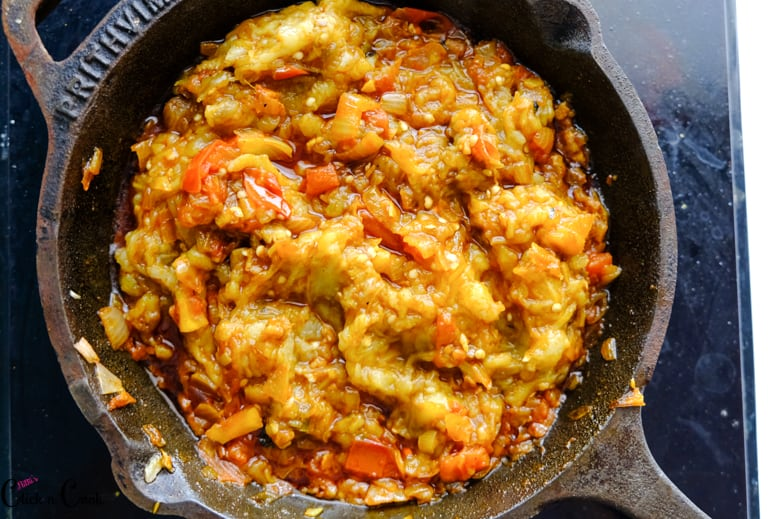 roasted eggplant mash is cooked in cast iron pan