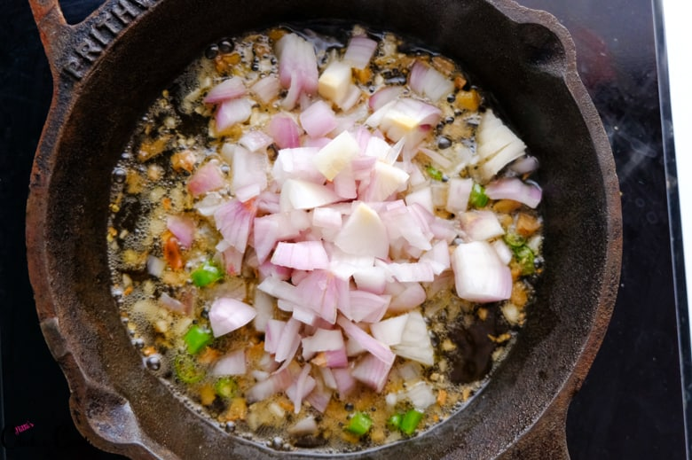 chopped onion in cast iron pan