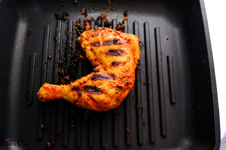chicken thigh is grilled in grill pan