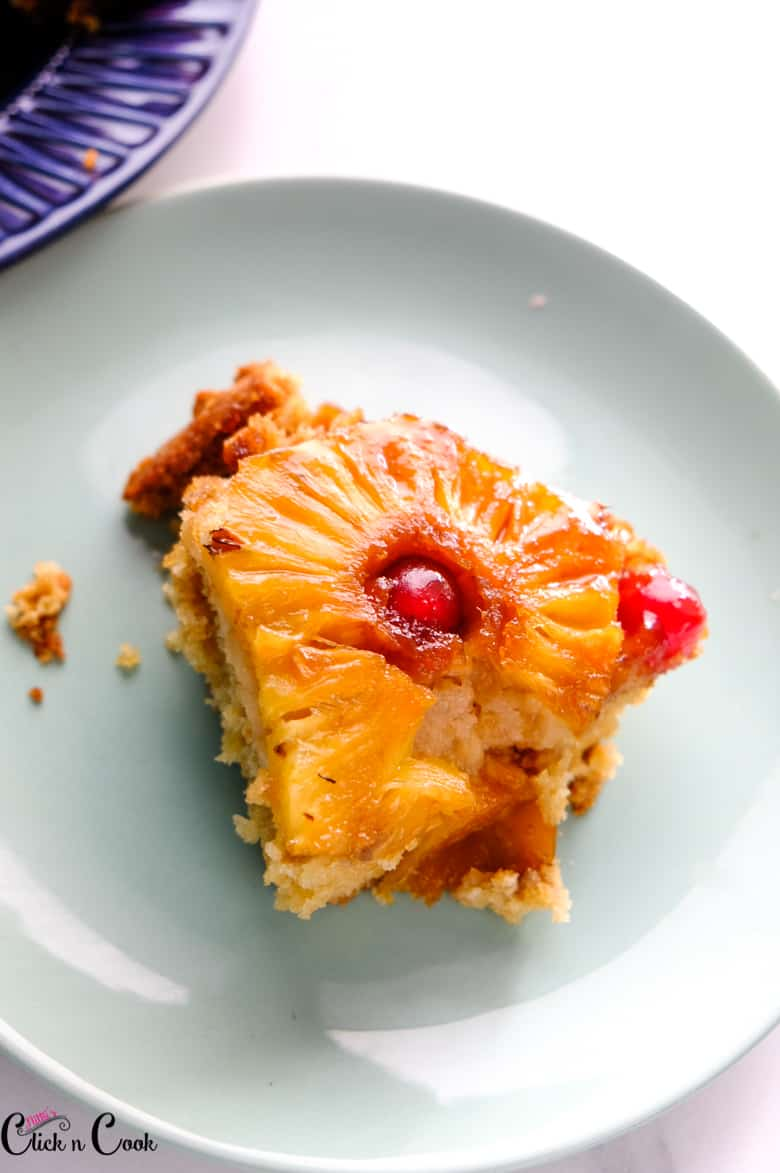 a slice of upside down cake in blue plate