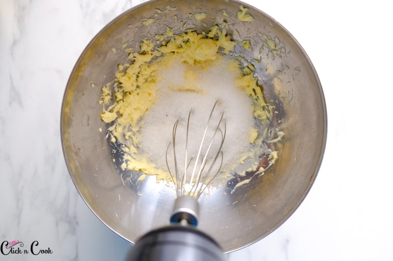 sugar and butter is being creamed together in mixing bowl