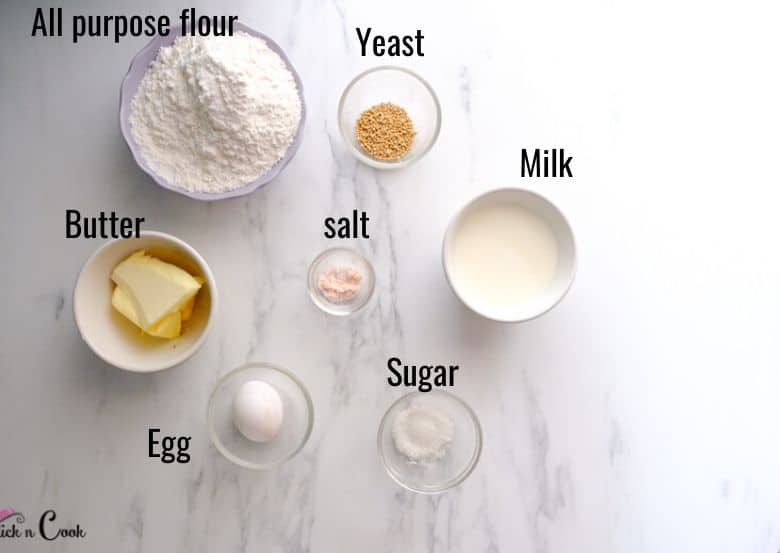 flour, yeast, milk and butter are taken in small bowls