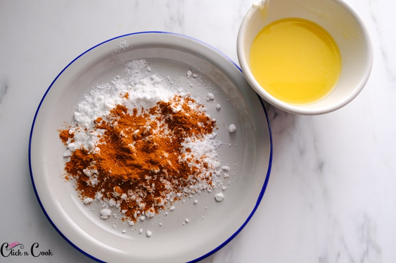 melted butter in small bowl and cinnamon sugar mixture in plate