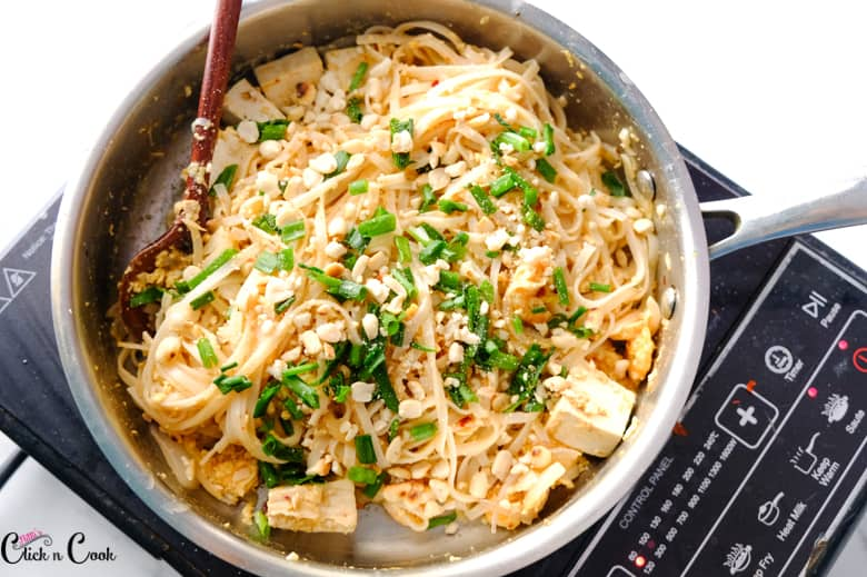 pad thai noodles in the sauce pan