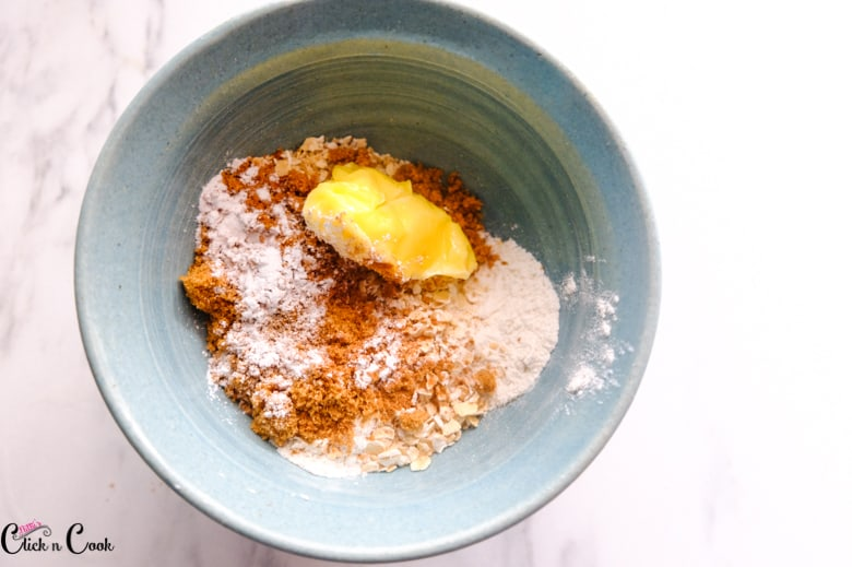 butter, brown sugar and all purpose flower in the blue mixing bowl