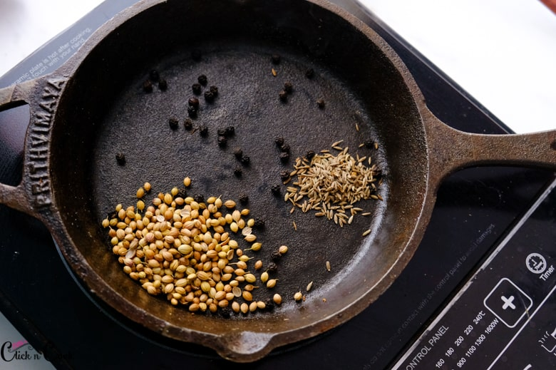 coriender seeds, peppercorns, cumin seeds are roasted in pan
