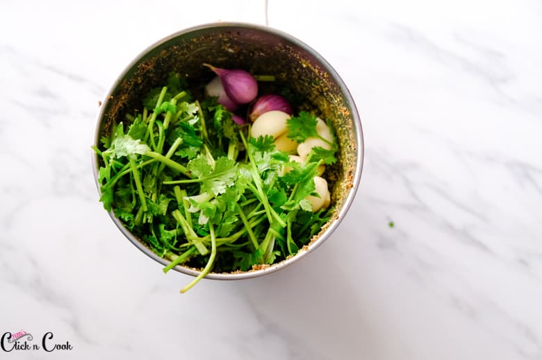 coriander leaves, shallots, garlic in the blender for green curry recipe
