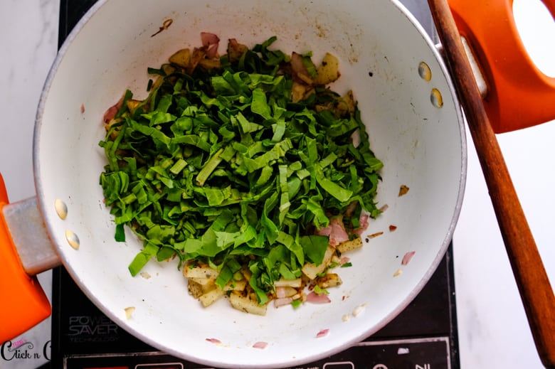 chopped spinach in the sauce pan