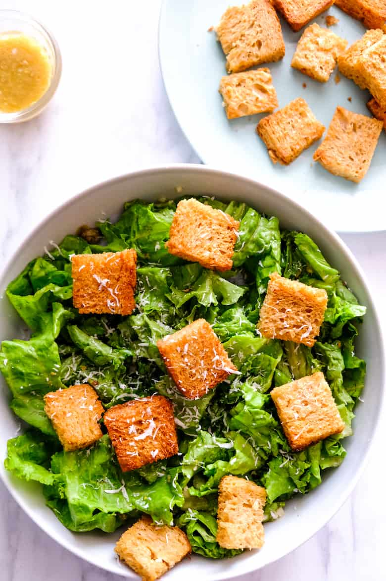 Caesar salad served in the bowl with croutons