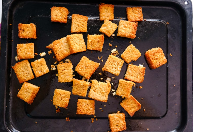Croutons are in the black baking tray.