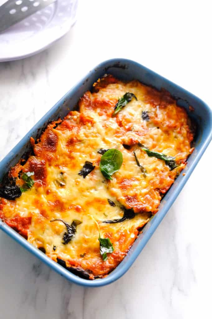 The eggplant parmesan recipe is in a blue baking tray