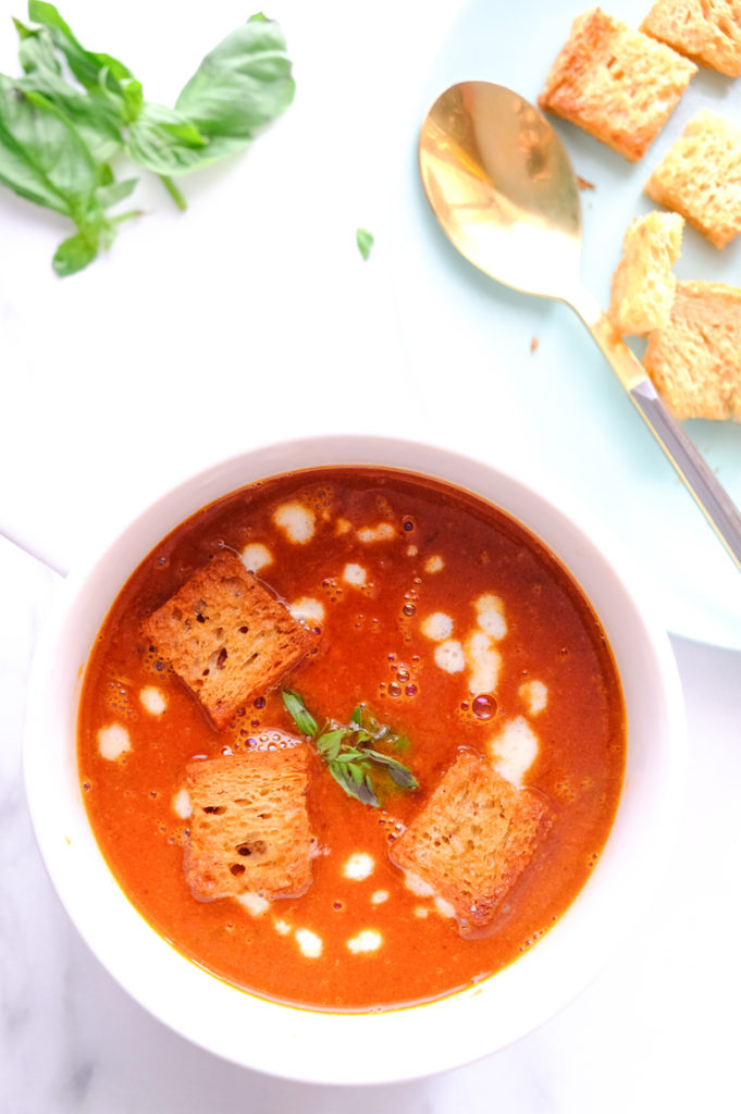 Tomato basil soup recipe is in soup bowl