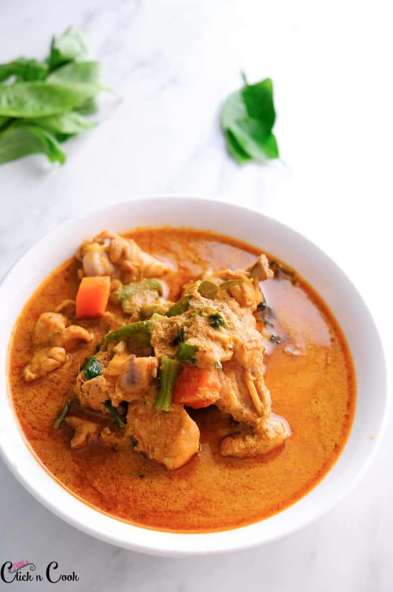 red curry recipe is served in white bowl