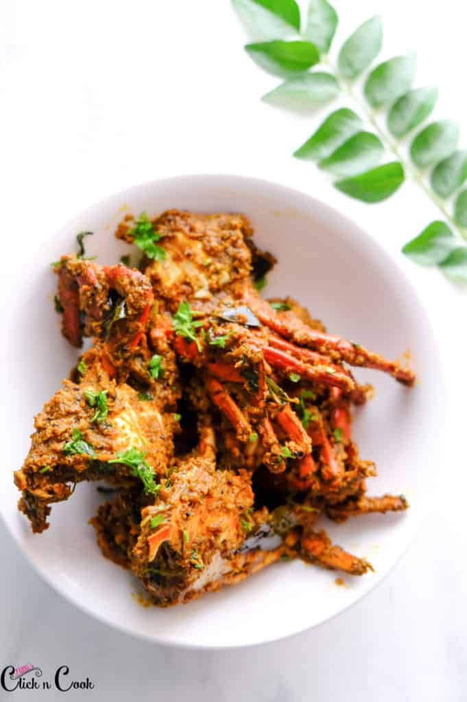 crab pepper masala served in white bowl.