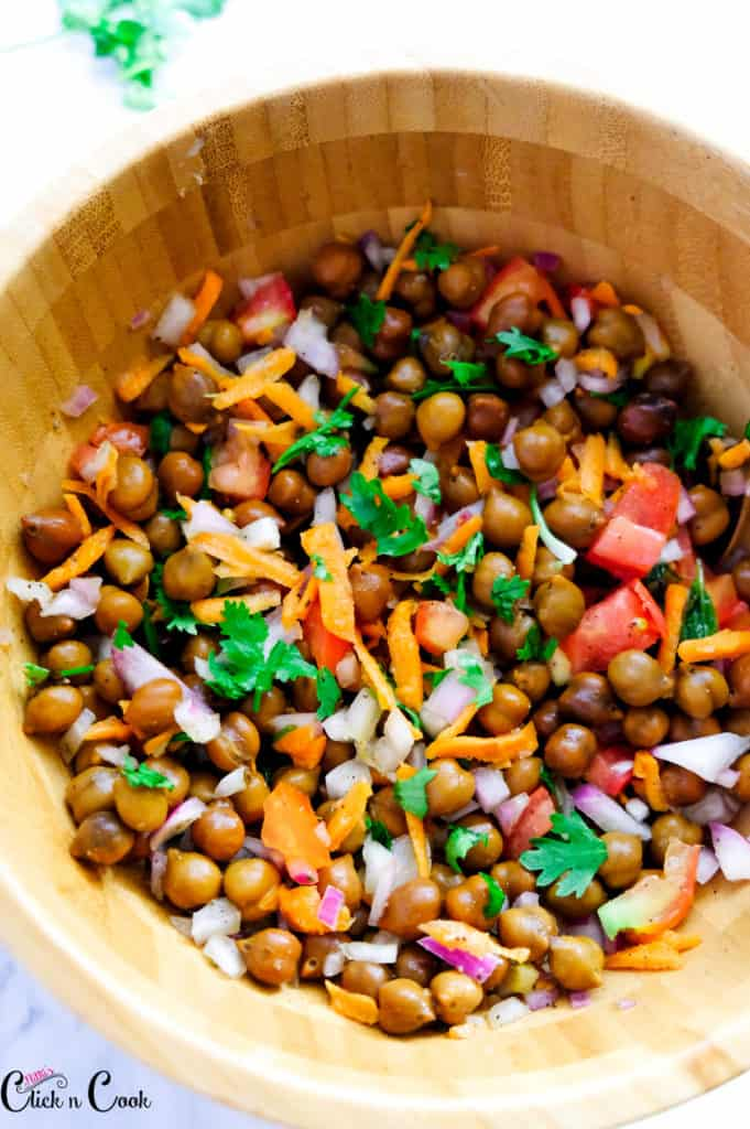 chickpea salad served in a wooden bowl